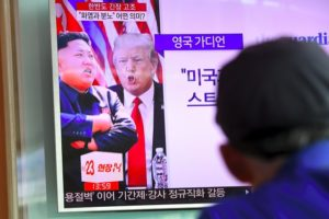 "A man watches a television news programme showing US President Donald Trump (C) and North Korean leader Kim Jong-Un (L) at a railway station in Seoul on August 9, 2017. President Donald Trump issued an apocalyptic warning to North Korea on Tuesday, saying it faces ""fire and fury"" over its missile program, after US media reported Pyongyang has successfully miniaturized a nuclear warhead. / AFP PHOTO / JUNG Yeon-Je (Photo credit should read JUNG YEON-JE/AFP/Getty Images)"